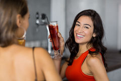 Two women having cocktail. In restaurant Royalty Free Stock Photography