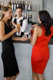 Two women having cocktail. In restaurant Stock Photo