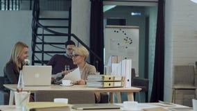 Two women having coffee break together in office stock video