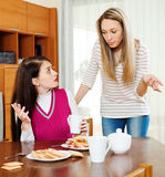 Two  women having conflict. At table in home Stock Photo