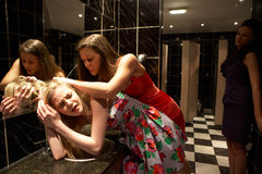 Two women having a fight in bathroom. At nightclub royalty free stock images