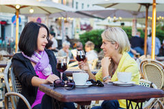 Two women having friendly chat in cafe Stock Images