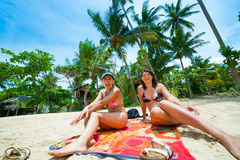 Two women having fun on a beach Royalty Free Stock Photos