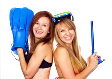 Two women having fun with diving equipment Stock Image