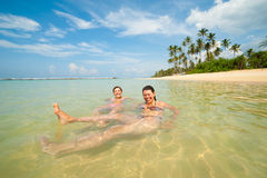 Two women having fun in the ocean Stock Photos