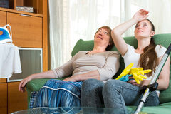 Two women having a rest after cleaning Royalty Free Stock Photo