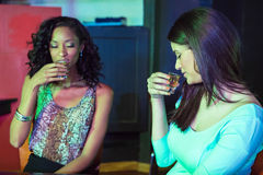 Two women having tequila Stock Images