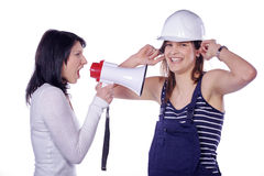 Two women with helmet and megaphone Stock Images