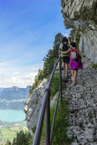Two women hikers walking in the mountains Stock Photos