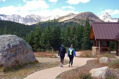 Two Women Hiking in the Rocky Mountains royalty free stock images