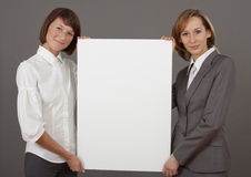 Two women holding blank board Royalty Free Stock Photography