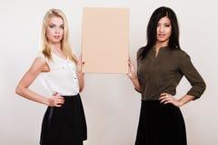 Two women holding blank board Stock Photo