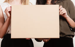 Two women holding blank board Royalty Free Stock Images