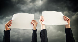 Two women holding blank paper Stock Photography