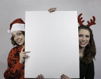 Two women holding blank sign Stock Photo