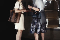 Two women holding designer handbags. Street style during new york fashion week stock images