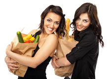 Two women holding groceries Stock Photo