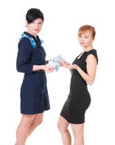 Two women holding money Royalty Free Stock Photos