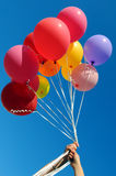Two women holding multicolored balloons Royalty Free Stock Image
