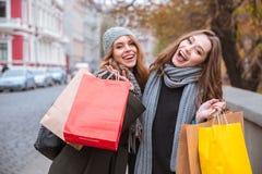 Two women holding shopping bags Stock Photo