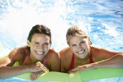 Two Women On Holiday In Swimming Pool Royalty Free Stock Images
