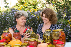 Two women and home canned vegetables Royalty Free Stock Images