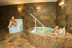 Two women at hot tub Stock Photography