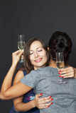 Two women hug each other Royalty Free Stock Image