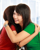 Two women hugging. Happy asian women hugging each other and smiling Royalty Free Stock Photos