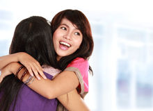 Two women hugging. Happy asian women hugging each other and smiling Stock Photos