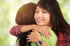 Two women hugging. Happy asian women hugging each other and smiling Stock Images