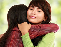 Two women hugging. Happy asian women hugging each other and smiling Royalty Free Stock Photography