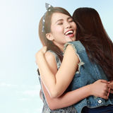 Two women hugging. Happy asian women hugging each other and smiling Stock Photo