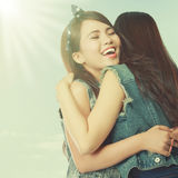 Two women hugging. Happy asian women hugging each other and smiling Stock Photography