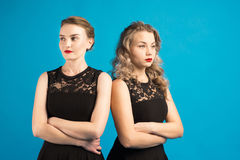 Two women in identical dresses are angry at each other Royalty Free Stock Photography
