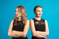 Two women in identical dresses are angry at each other Stock Photography