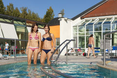 Two Women In Swimming Pool Royalty Free Stock Image