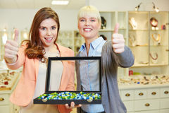Two women in jewelry store Royalty Free Stock Image