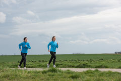Two women jogging outdoors Royalty Free Stock Photo