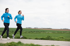 Two women jogging outdoors Stock Photo