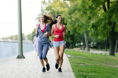 Two women jogging in park Royalty Free Stock Photography