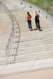 Two women jogging up steps. Two young women exercising by running up steps Royalty Free Stock Photography
