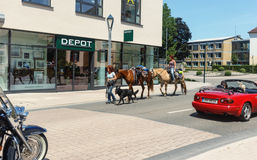 Two women journeys with horses. BÜHL,GERMANY-JUNE 28, 2015:nTwo women journeys with horses through the streets of the city Bühl.Baden-Wurttenberg.Germany royalty free stock image