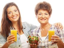 Two women with juice and salad Stock Photography