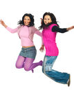 Two women jumping Stock Photos