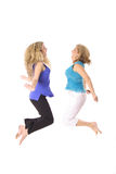 Two women jumping Stock Photography