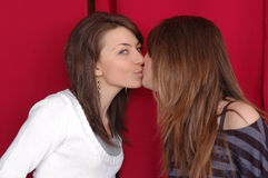 Two women kissing. Two attractive girlfriends giving a kiss on the lips Stock Photo