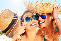 Two women kissing friend on the beach Royalty Free Stock Image