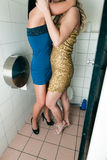 Two women kissing in the toilet Royalty Free Stock Photos