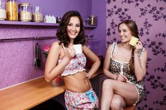 Two Women In Kitchen Royalty Free Stock Image